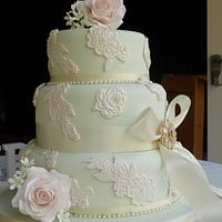 Embossed lace and sugar rose wedding cake