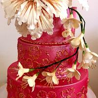 Gold and red brush embroidery cake