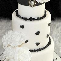 Black and White cake with white roses
