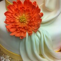 Draped cake with Gerber Daisies