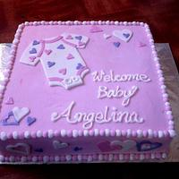 Baby shower onsie cake
