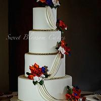 Wedding cake with fall colored sugar flowers and little gold accent