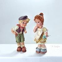 Just two figurines. No name, just dolls.
