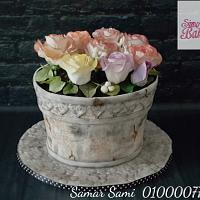 Antique Pot Cake with sugar roses of different colors.