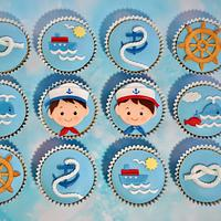 Nautical cupcakes for two little twins .
