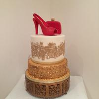 Red crocodile effect shoe and bag with golden lace and sequin cakes