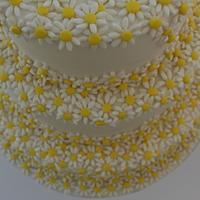 Cascading daisy wedding cake