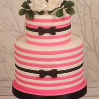 Pink and white striped cake