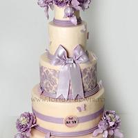 Baroque wedding cake with purple peonies