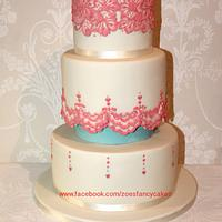 Coral and ivory coloured wedding cake