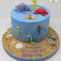 Sea and Travel themed 1st birthday cake