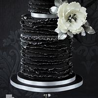 Black friday ruffles birthday cake