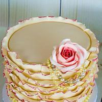 Ivory and coral ruffled wedding cake