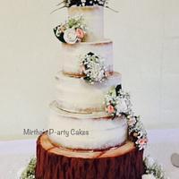 Semi naked wedding cake with edible log stand