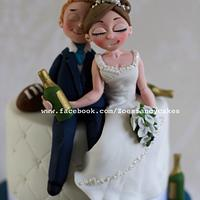 Drunken bride and groom wedding cake