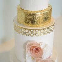 Signature wafer paper flowers with classic gold leaf