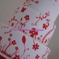 Handpainted Red & White Wedding Cake by Sam Harrison