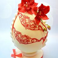 Easter egg decorated with sugar orchids