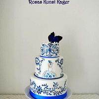 Blue-white wedding cake with cupcakes