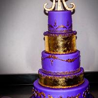 Violet and gold wedding cake.
