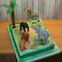 Jungle animals playing soccer