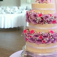 Cigarillos wedding cake with fresh flowers