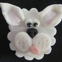 Fondant puppy cupcake topper