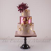 Suede, shimmering marsala and antiqued gold wedding cake