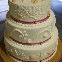 Hot pink and sage beach wedding cake