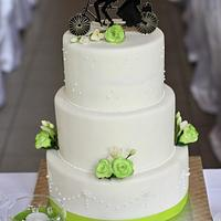 Wedding cake with cycling couple