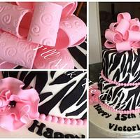 Zebra print cake with a loopy bow.