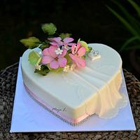 Heart shaped wedding cake with cosmos flowers