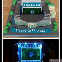 Stamford bridge Chelsea football stadium cake with 'floodlights'