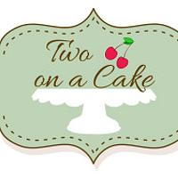 Two cherries on a cake