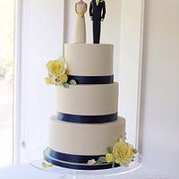 Yellow and navy themed wedding cake