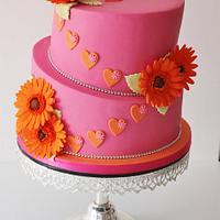 Hot pink topsy turvy wedding cake with hand made sugar gerbera's and hearts