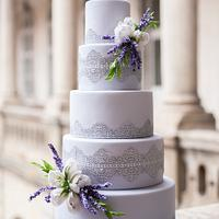 Wedding cake with lace , lavender and tulips