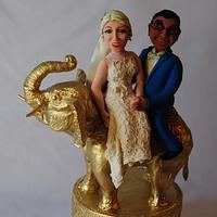 Bride and groom on a golden elephant