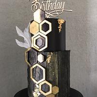 Elegant birthday cake in black & gold