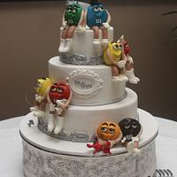 M&M Wedding Cake  all edible with bridal party professions