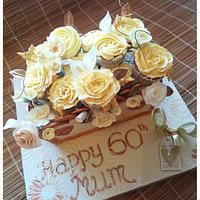 Golden birthday cake with hand made flowers
