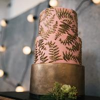 Pink and copper cake with ferns