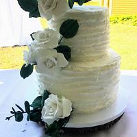Rustic wedding cake with sugar roses