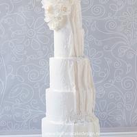 Classy white lace wedding cake