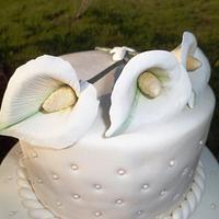 Calla Lilies on a White Wedding Cake by Joyce Nimmo