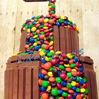 Gravity-defying M&M Vanilla Birthday Cake