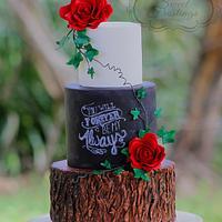 Rustic chalkboard and tree stump wedding cake