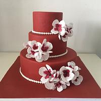 Red cake and wafer paper flowers