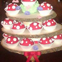 Toadstool cup cakes on tree stand