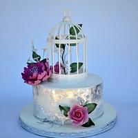 wedding cake with edible silver leaf and bird cage